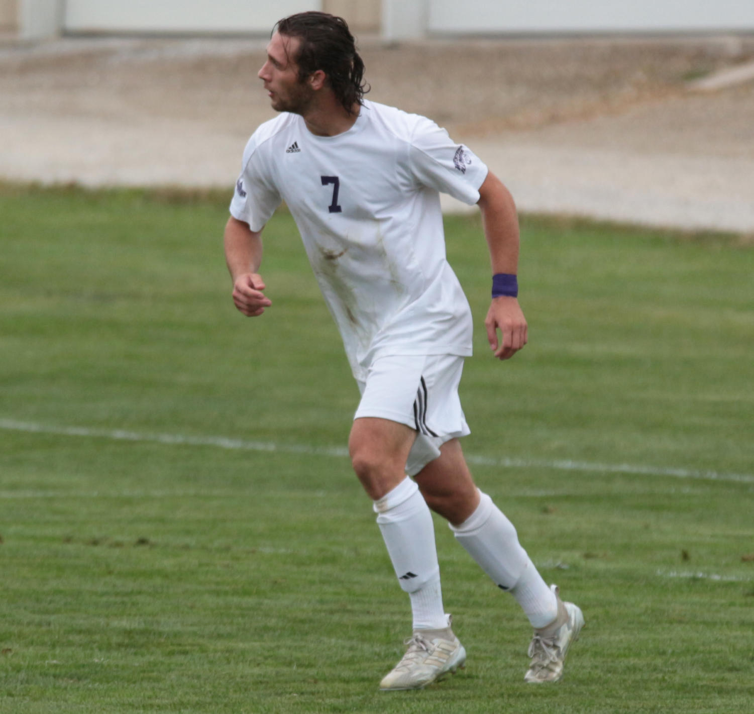Drew Whalen midstride in a game on the exhibition field.