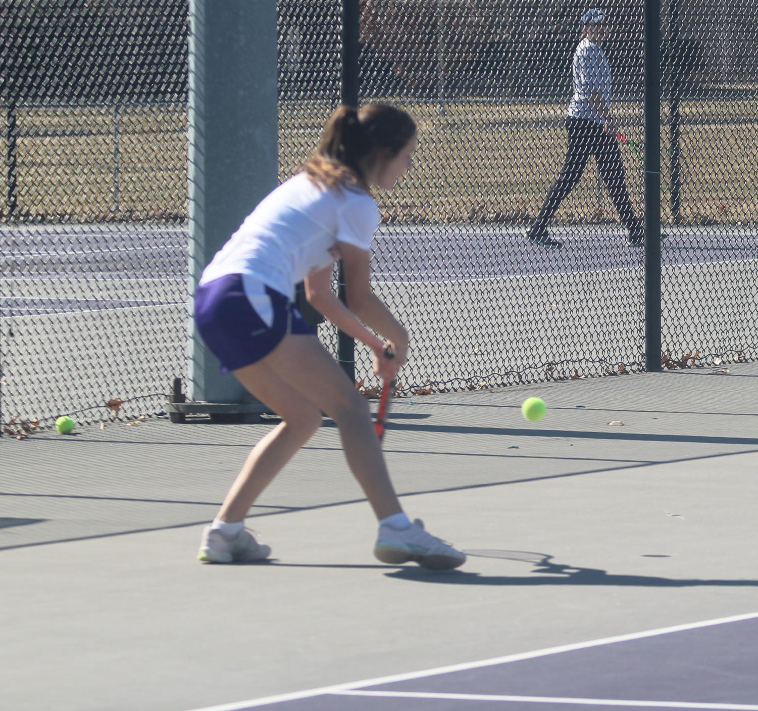 Mary Bjelica angles herself to hit the ball at a home match in Macomb.