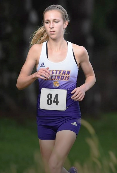 Nicole Beebe runs in a home meet here in Macomb, Ill.