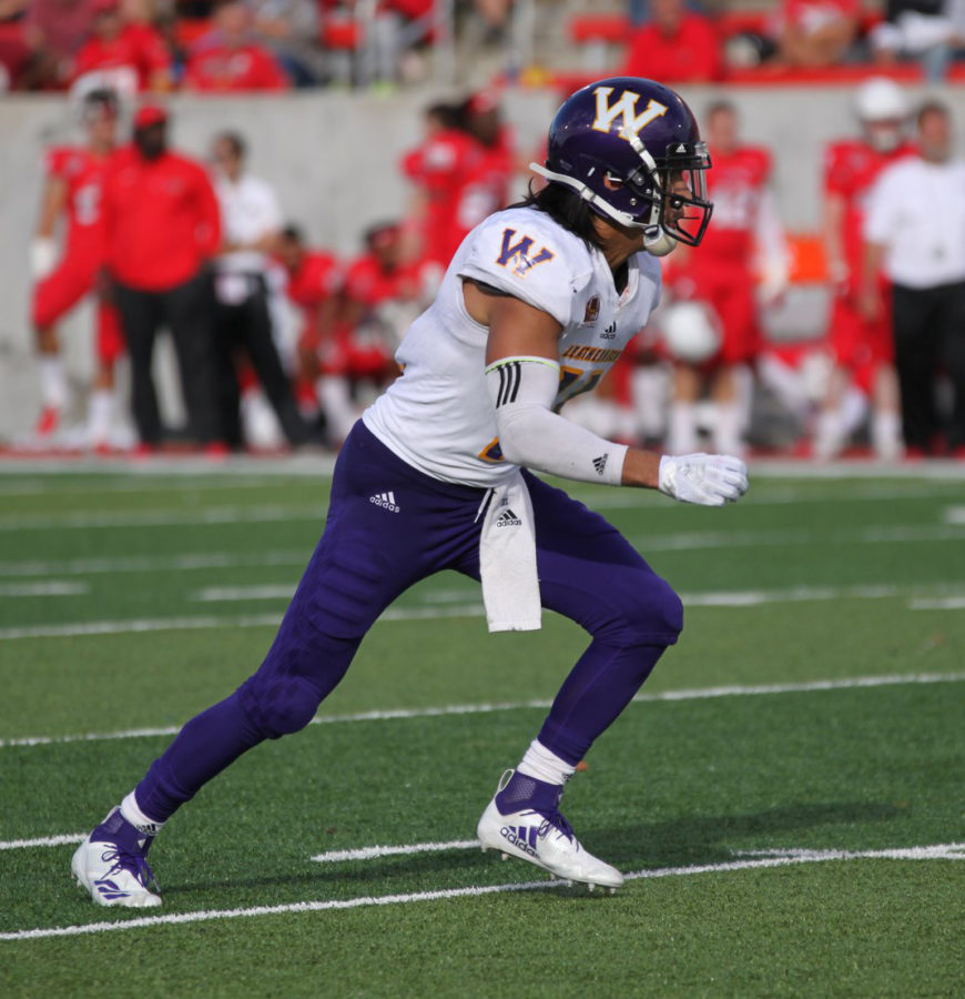 Eric Carrera running to the play at an away game against the Illinois State University Redbirds.