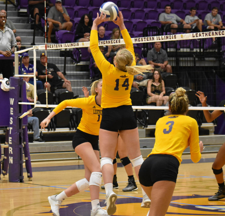 Cassie Hunt sets the ball for her teammate Riley Schumacher inside Western Hall.