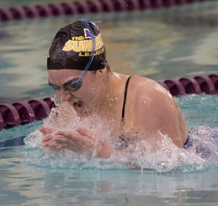 Erica Hagen comes up for a breath during her breast stroke event.