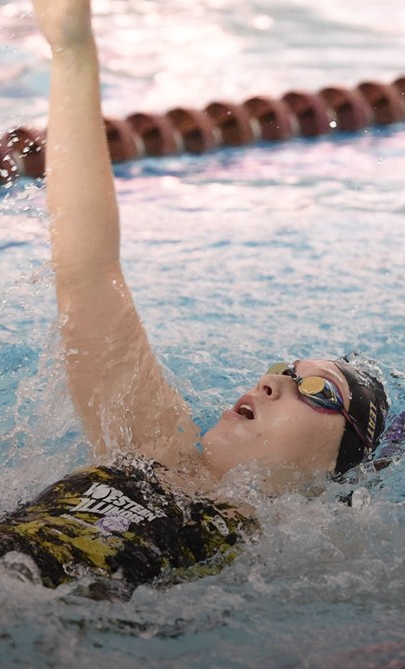 Erica Hagen competes in the backstroke event.