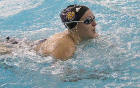 Swimming sinks in home meet