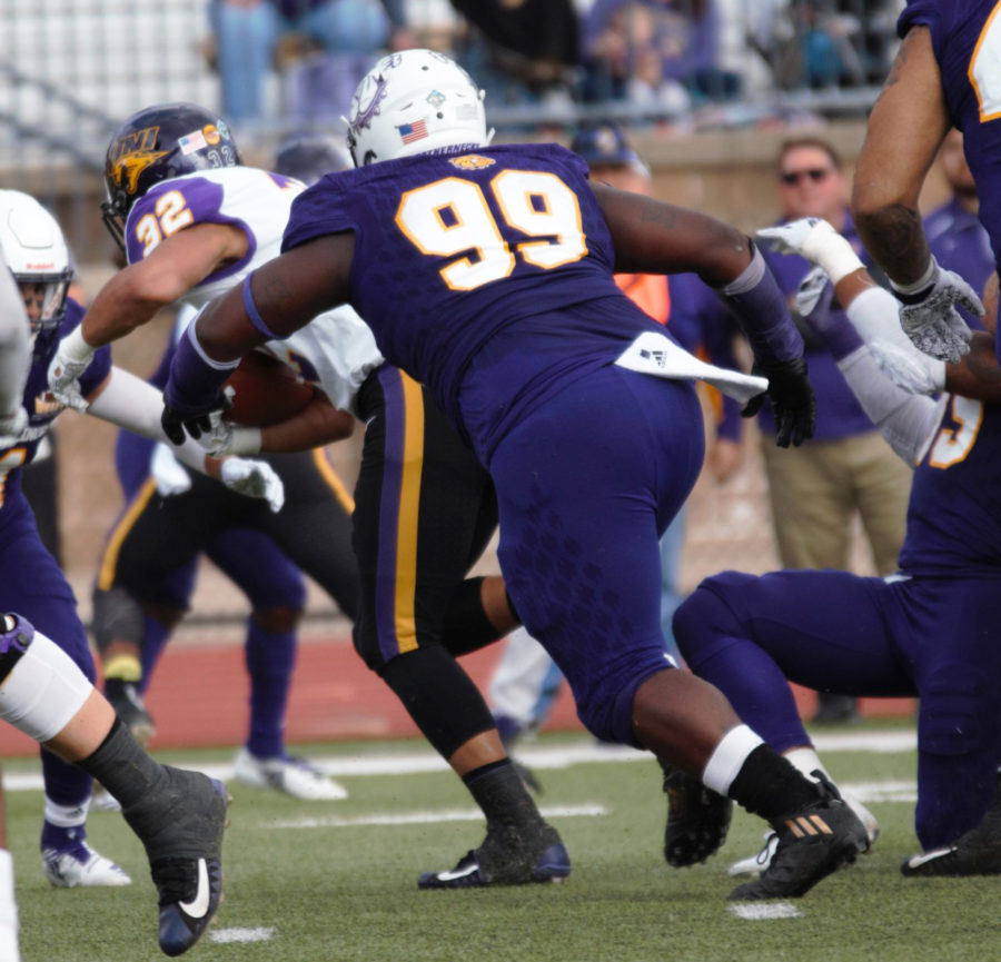 Khalen Saunders goes to tackle a University of Northern Iowa player at a home game on Hanson Field.