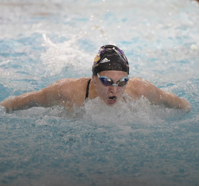 Miranda Mathus competes in the butterfly event at a home meet in Macomb.