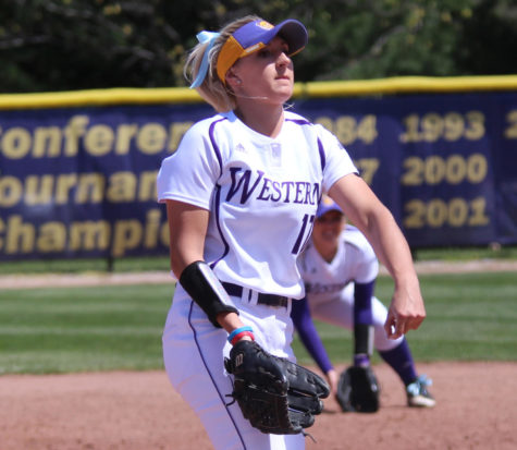 Softball drops two extra-inning games at home