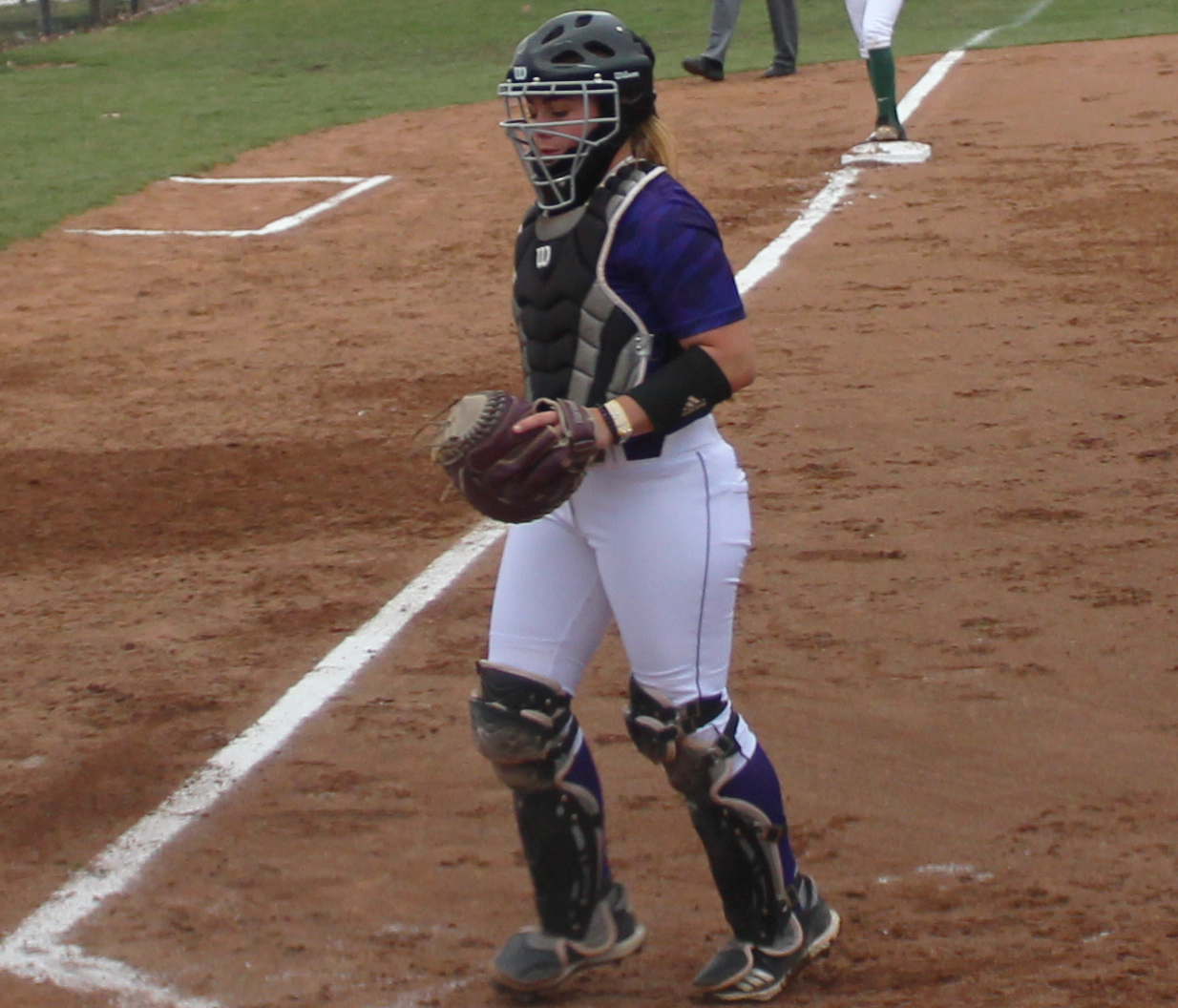 Meghan Henson jogs back to behind home plate.