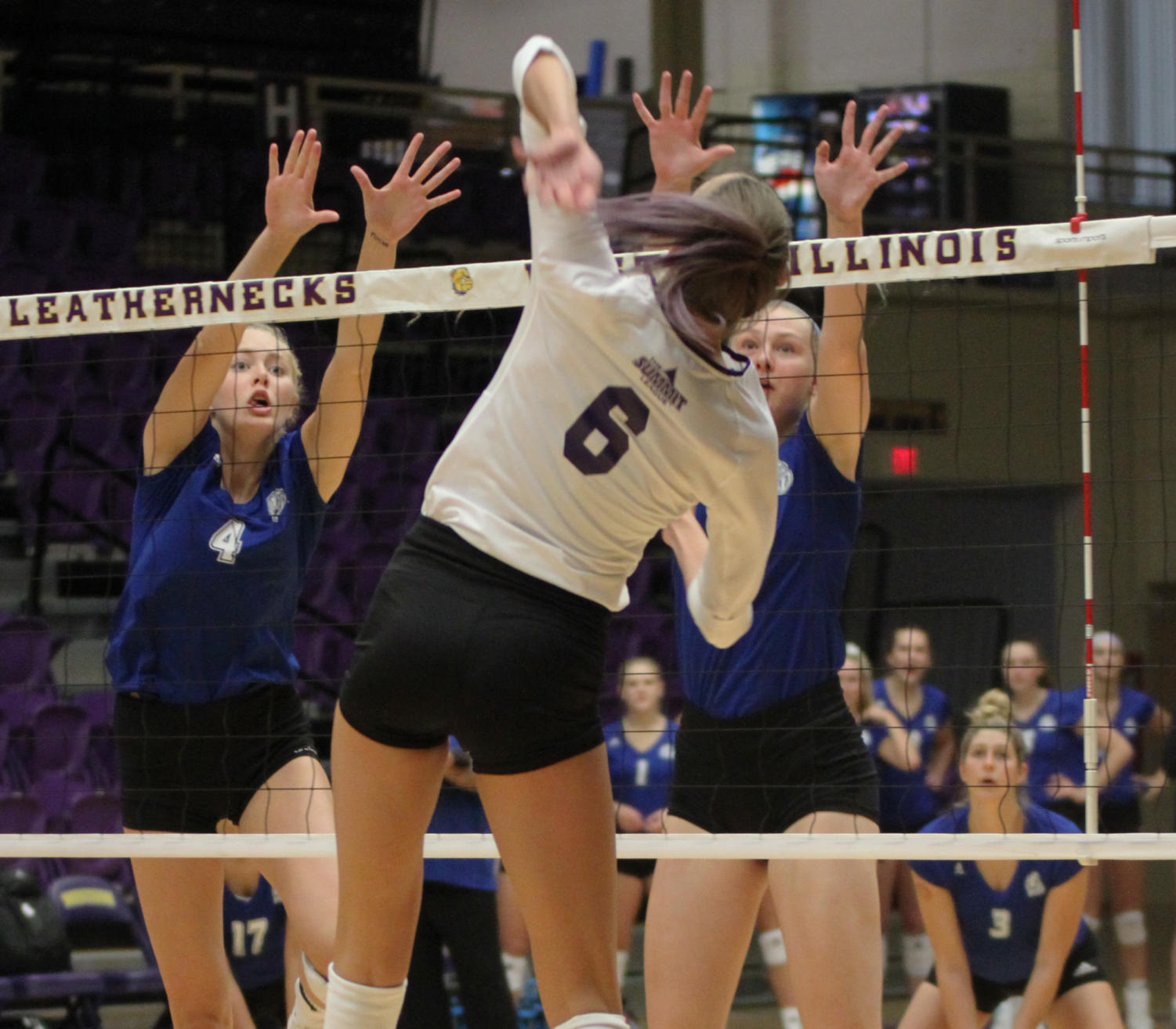 Mariah Mitchell goes up to the net for a kill.