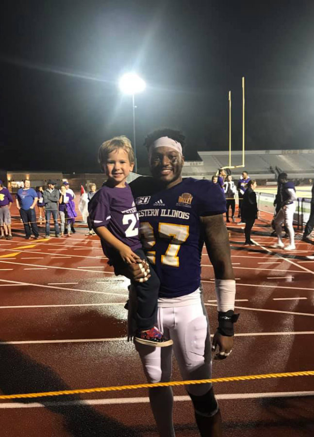 Jace+Skwara+was+named+Honorary+Captain+and+posed+with+lineman+Tre+Hendon+after+the+game.