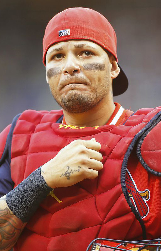 Yadier+Molina+looks+into+the+crowd+during+a+game.