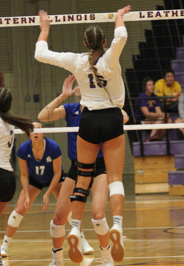 Mackenzie Steckler goes up to spike the ball.