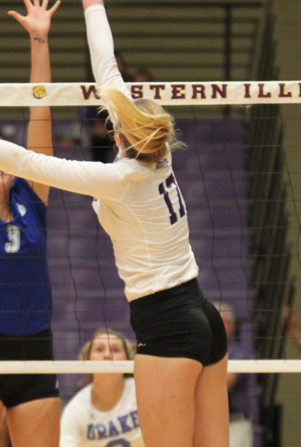 Riley Schumacher tries to tip the ball over the net.