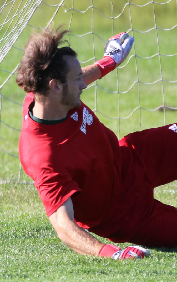 Tim Trilk dives to the ground to make a save.