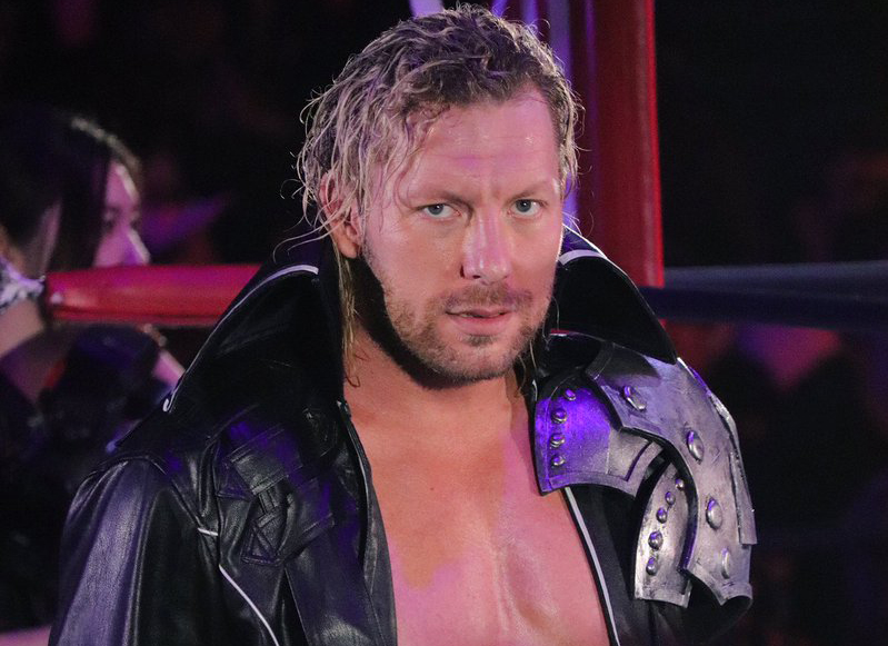 Kenny+Omega+walks+into+the+ring+for+his+match.